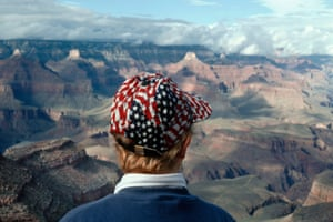 A tourist in front of the Grand Canyon.