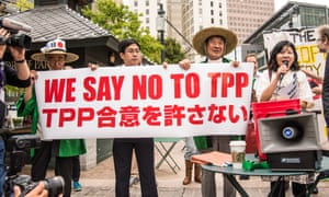 Protesters oppose Trans-Pacific Partnership trade talks in Atlanta<br>01 Oct 2015, Atlanta, Georgia, USA --- Atlanta, United States. 1st October 2015 -- At a rally in Atlanta, protesters from Japan speak in opposition to the Trans-Pacific Partnership trade agreement. -- Protesters opposed to the Trans-Pacific Partnership trade negotiations held two rallies and marches in Atlanta where the talks were being held in the Westin Hotel. Activists criticized the secrecy and the role of corporations in the negotiations. --- Image by © Steve Eberhardt/Demotix/Corbis