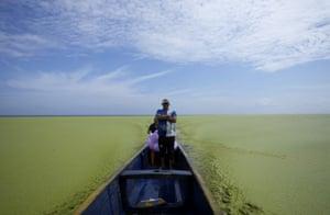 A fisherman stands on a boat at the Ciénaga Grande de Santa Marta in Colombia