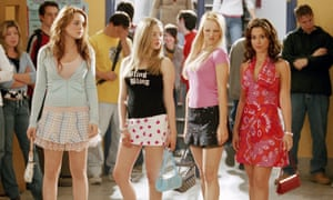 Amanda Seyfried, Rachel McAdams and Lacey Chabert standing in a row in Mean Girls (2004).