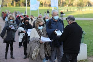 People present their coronavirus vaccination certificate or 'green badge' at a concert in Tel Aviv, Israel.