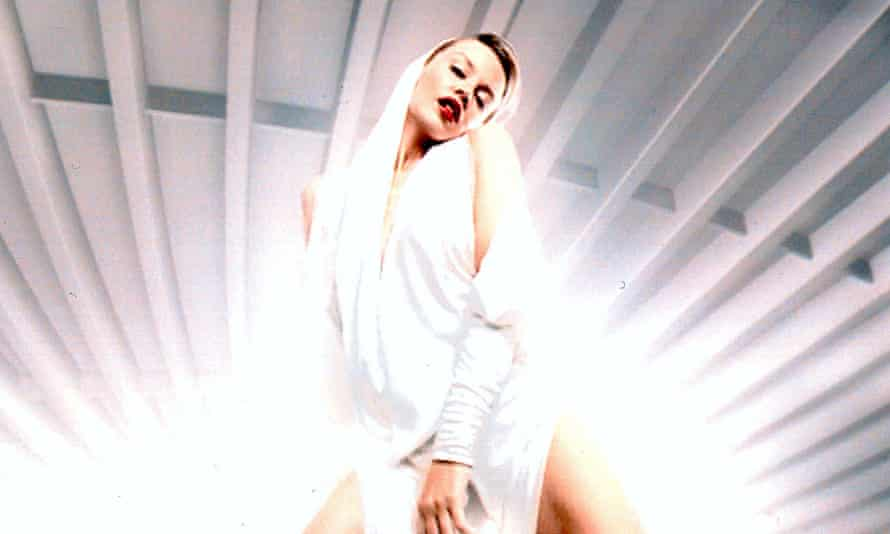 Kylie Minogue in a hooded white outfit for the Can't Get You Out Of My Head video, 2001.