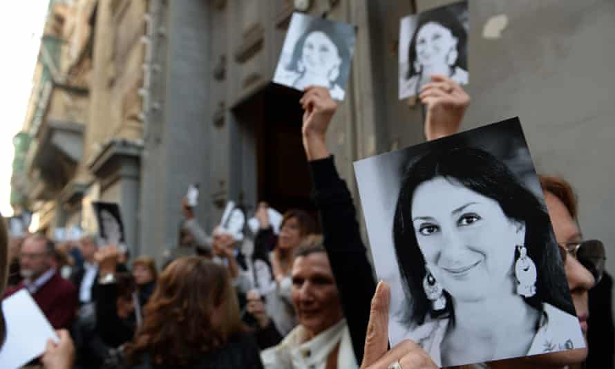Supporters of Daphne Caruana Galizia leaving church in Valletta earlier this month