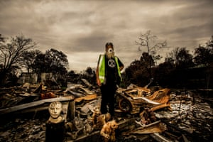 """Artist Don Ashby stands in the remains of what was his family home, studio and workshop. """"Although it seems as though my house has disappeared, it hasn't. It's still here in my mind. Watching my house burn down was sad but it was also a relief. I mean, I don't have all of this stuff anymore. I feel light."""""""