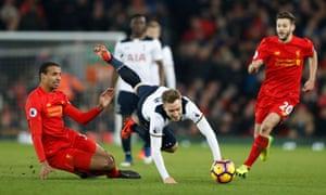 Liverpool's Joel Matip brings down Tottenham's Christian Eriksen.