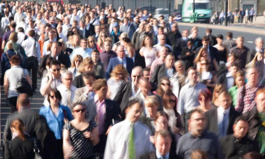 Commuters on London Bridge during rush hour