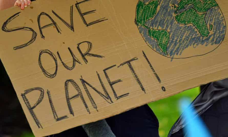 A placard held by climate activists outside the Shell building in London in 2020.