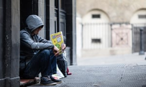 Homeless man holds the Big Issue