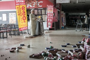 The KFC Colonel and manikins are left standing in a Fukushima supermarket.