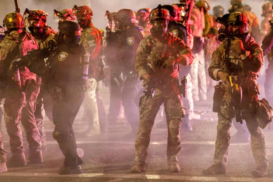 Federal police under the orders of Donald Trump launch teargas after a demonstration in Portland, Oregon, on Thursday.
