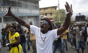 """A demonstrator chants: """"Down with Martelly!"""" during a protest in Port-au-Prince, Haiti, last month."""