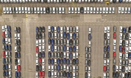 Recently assembled Vauxhall vehicles are stored in the distribution yard at the Vauxhall car factory in Ellesmere Port