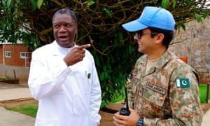Congolese gynaecologist Denis Mukwege (L) chats with a Pakistani Monusco soldier tasked with his protection at Panzi Hospital
