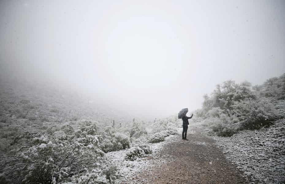 The Arizona desert landscape at Sentinel Peak covered in snow.