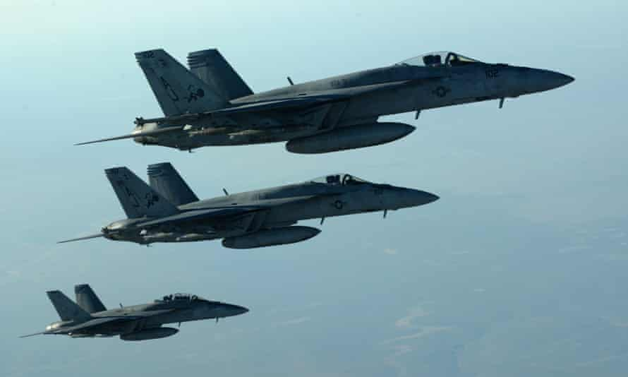 US Navy F-18E Super Hornets, which were part of a large coalition strike package to strike ISIS targets in Syria. The involvement of British pilots in Syria is likely to anger MPs who voted against action in that country by the UK.