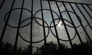 The Olympics rings are seen on a fence in front of the Russian Olympic Committee building in Moscow, but the barriers to participation in Rio are uncertain.