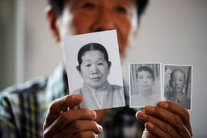 A man shows pictures of his deceased mother and little brothers living in North Korea.