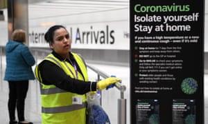 A worker cleans a rail at Heathrow