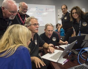 New Hoizons principal investigator Alan Stern of Southwest Research Institute, with other team members, views new images from the spacecraft for the first time