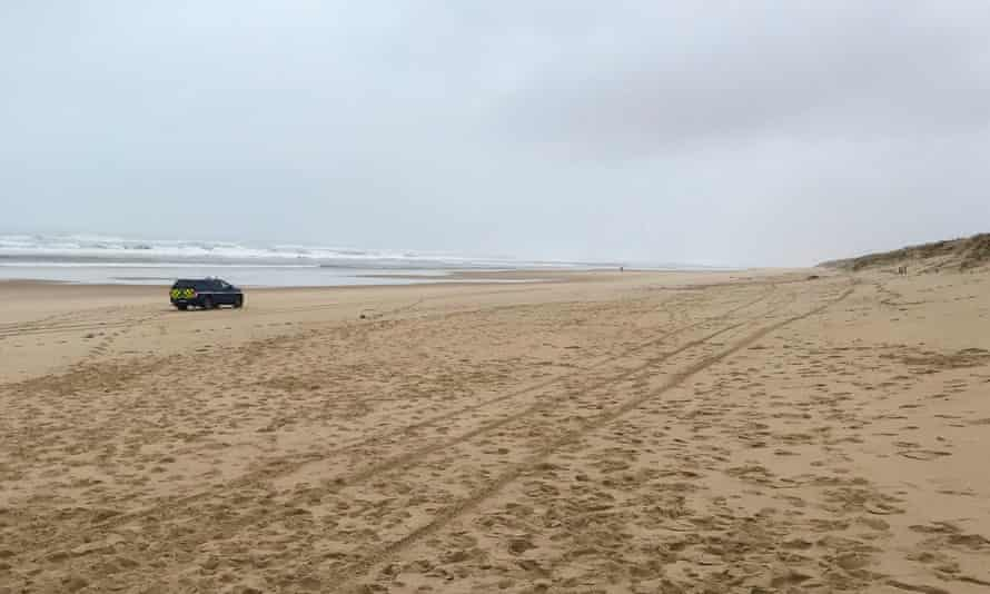 A police car is seen on the Plage du Gressier in Le Porge,