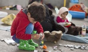 Migrant children play