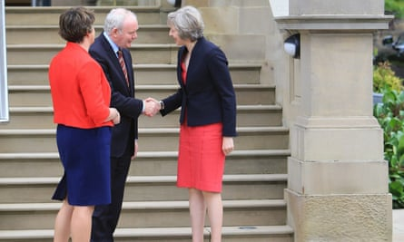 Theresa May is greeted by Martin McGuinness and Arlene Foster