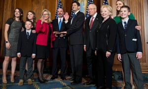 Former US vice-president Dick Cheney, fourth right, poses with Paul Ryan, as his daughter, US congresswoman Liz Cheney, fourth left, is sworn in during the opening of the 115th US Congress on 3 January 2017.