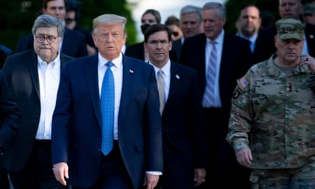 Donald Trump walks with aides including secretary of defense Mark Esper and chairman of the Joint Chiefs of Staff Mark Milley.