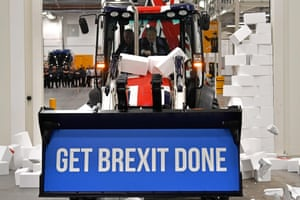 Uttoxeter, UKBritain's Prime Minister Boris Johnson drives a JCB, with the words Get Brexit Done inside the digger bucket, through a fake wall