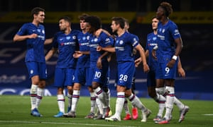 Willian celebrates with teammates after scoring his Chelsea's second goal against Manchester City from the penalty spot