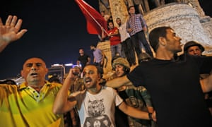 Supporters of Turkey's president Recep Tayyip Erdoğan, protest in front of soldiers in Istanbul early Saturday, 16 July.