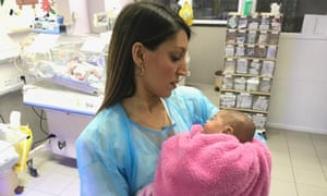 Rosena Allin-Khan with a young patient at a hospital on the West Bank