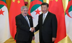Chinese president Xi Jinping shakes hands with former Algerian prime minister Ahmed Ouyahia in 2018.