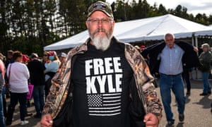 A Trump supporter wears a shirt that reads