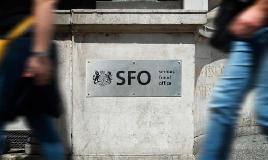 Pedestrians walk past  the headquarters of the Serious Fraud Office in London