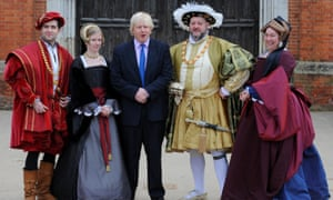 Boris Johnson poses with actors portraying Henry VIII, among others