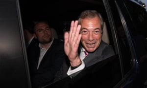 UKIP Leader Nigel Farage drives away from the Leave.EU party in London.
