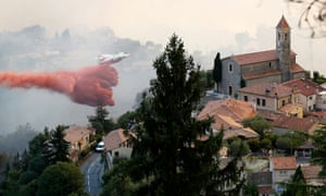 A firefighting aircraft attends to the scene of a forest fire in the town of Castagniers near Nice, France