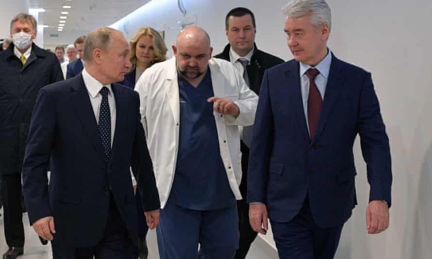 Russia's president, Vladimir Putin, visits a medical facility in Kommunarka