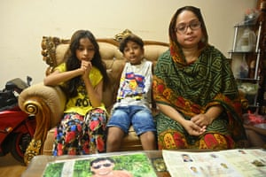Farzana Akter sits with children on a sofa