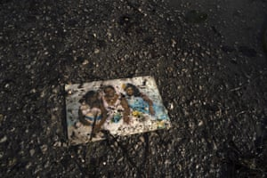 A family photo lies on a muddied road in the aftermath of Hurricane Dorian in Pine Bay, near Freeport, Bahamas, Wednesday