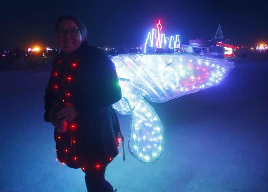Lelah Vaga wears butterfly wings at Burning Man.