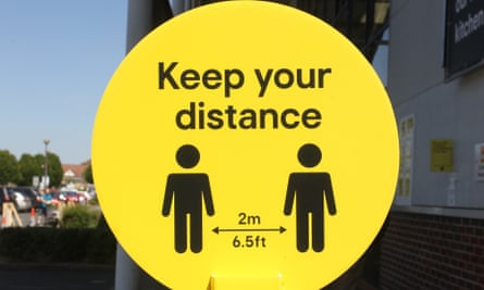 A social-distancing sign at a shopping centre in Braintree, Essex.