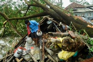 A man retrieves items from his house damaged by super-cyclone Amphan in Midnapore, India