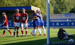 Chelsea's Pernille Harder (centre) celebrates scoring her side's eighth goal.