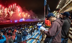 """Punters check the form at the Sha Tin racecourse in Hong Kong. Martin Purbrick, of the Hong Kong Jockey Club, has warned of a """"tsunami of illegal betting"""" in the region."""