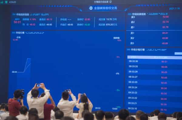 A screen displaying real-time information about carbon emission trading in Wuhan, China