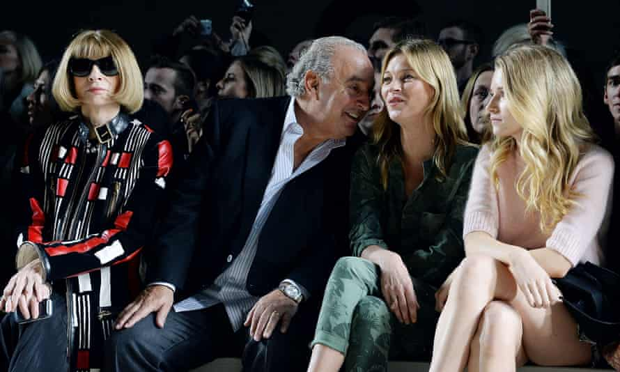 Anna Wintour, Sir Philip Green, Kate Moss and Lottie Moss attend the Topshop Unique show at London Fashion Week AW14 at Tate Modern in 2014.