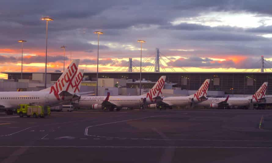 Aircraft from Virgin Australia sit on the tarmac at Sydney Airport. Administrators have warned that the airline sale process risks failure without government support.