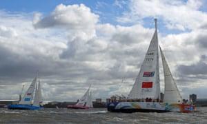 Wendy Tuck's yacht, the Sanya Serenity Coast races toward the finish at Liverpool's Albert Dock